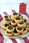 close-up of stacked peanut butter cup cookies on plate