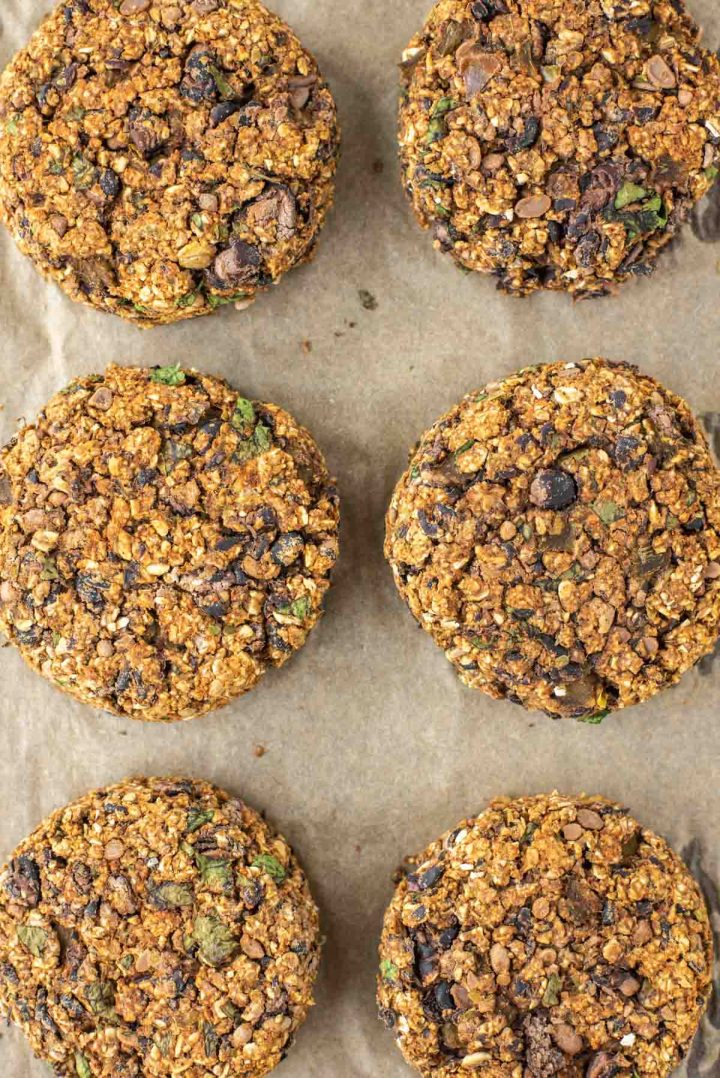 overhead shot of black bean burgers on parchment paper-lined baking sheet