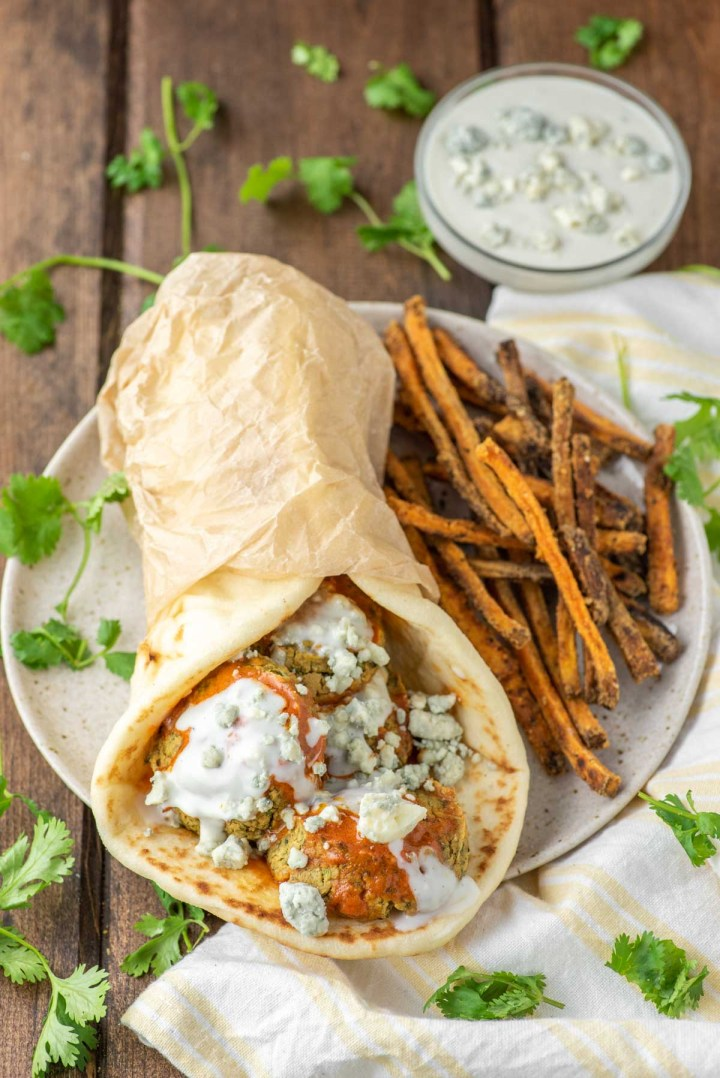 buffalo falafel with naan and sweet potato fries on plate