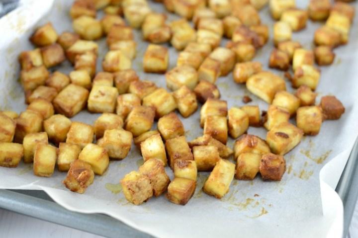 close-up of crispy baked tofu in baking sheet
