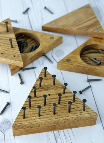 close-up of DIY triangle peg game