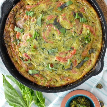 overhead shot of roasted red pepper frittata in cast iron skillet