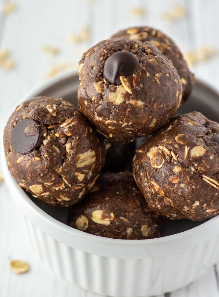 close-up of chocolate peanut butter energy balls in white ramekin