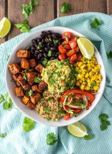 overhead shot of vegetarian burrito bowl in white plate