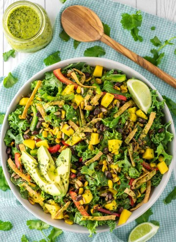 overhead shot of mango quinoa salad in bowl with cilantro lime vinaigrette