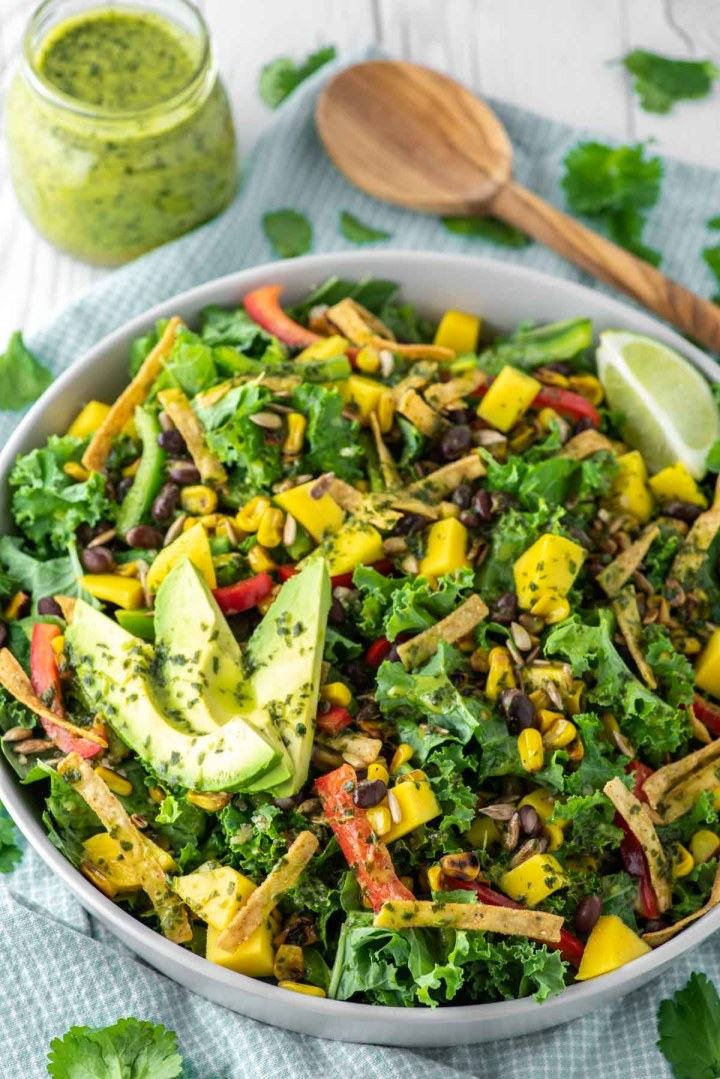mango quinoa salad in bowl with cilantro lime vinaigrette