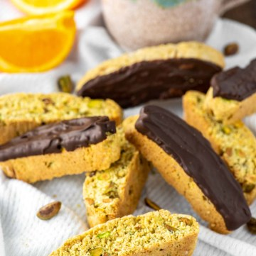 orange pistachio biscotti on dish towel