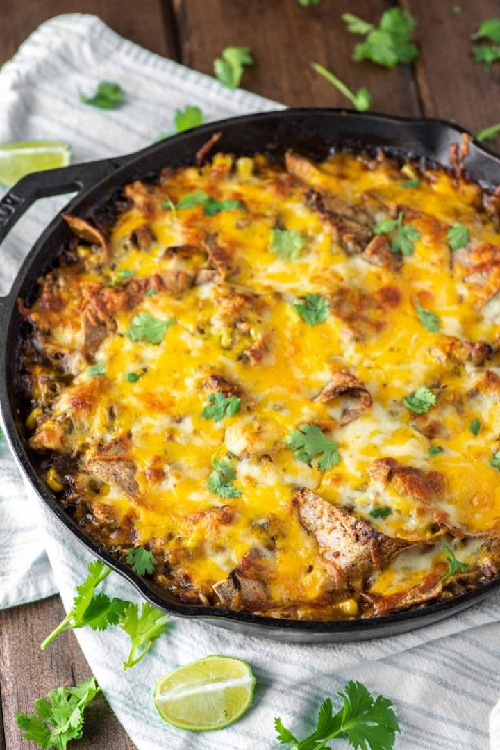 cheesy chicken enchilada skillet in cast iron