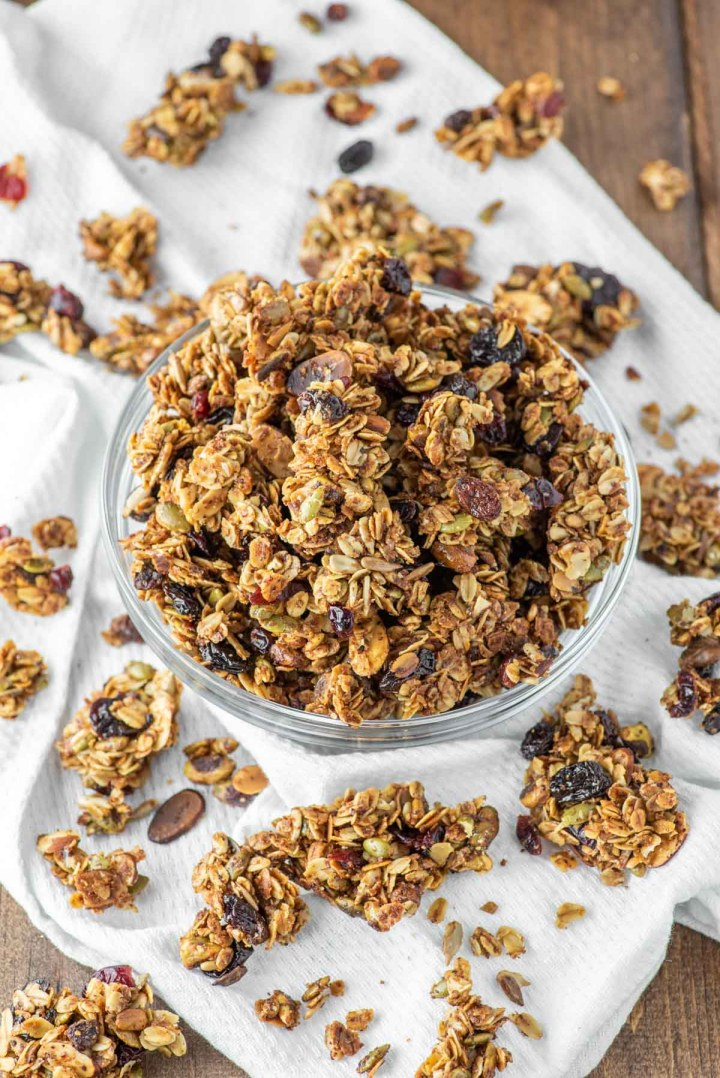 fruit and nut granola in glass bowl on white dish towel
