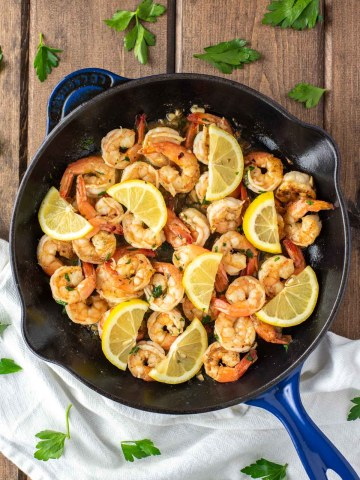 overhead shot of lemon garlic butter shrimp in skillet