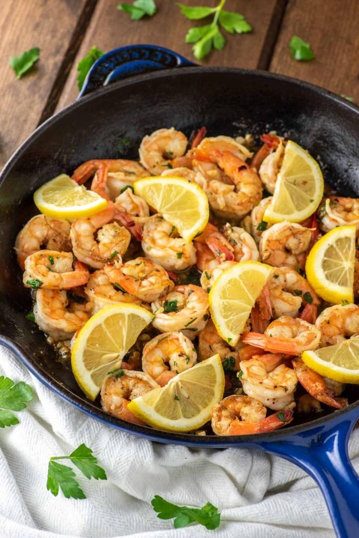 close-up of lemon garlic butter shrimp in skillet