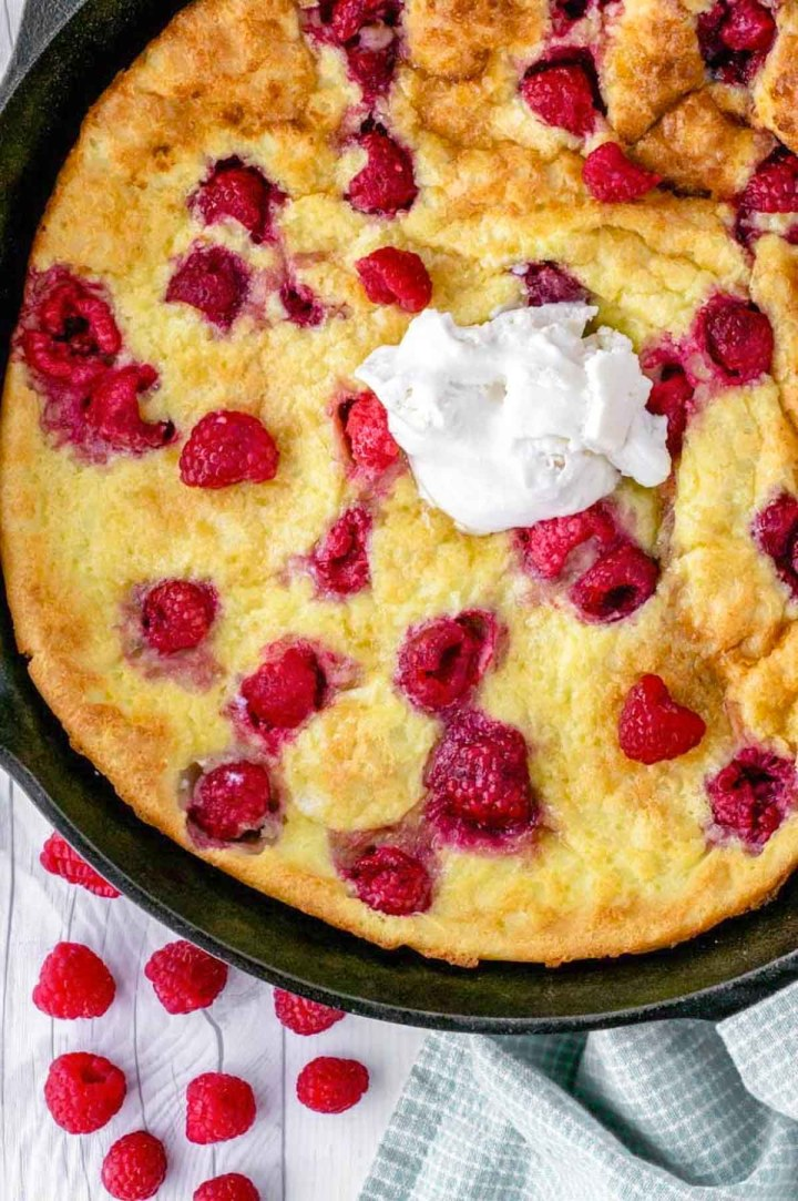 overhead shot of raspberry lemon dutch baby in skillet