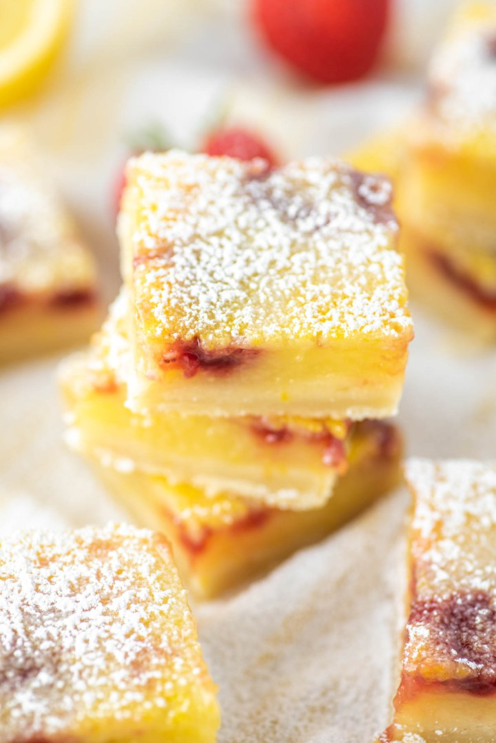 strawberry lemon bars stacked on top of each other on dish towel