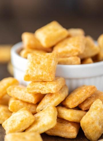 homemade cheese crackers falling out of white ramekin