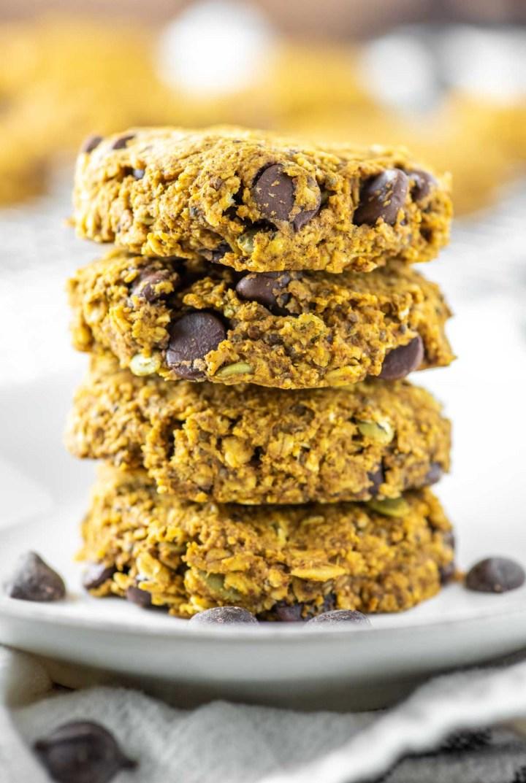 4 pumpkin breakfast cookies stacked on plate