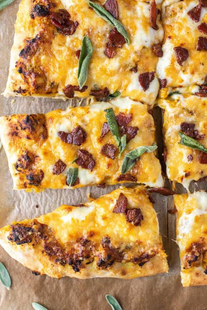overhead shot of cut up slices of pumpkin pizza