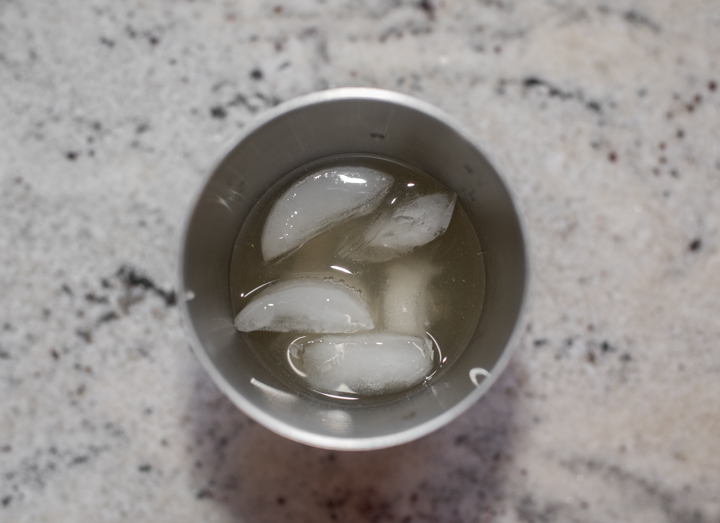 apple cider, vodka and lemon juice in cocktail shaker with ice