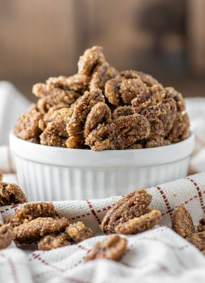 candied pecans in white ramekin
