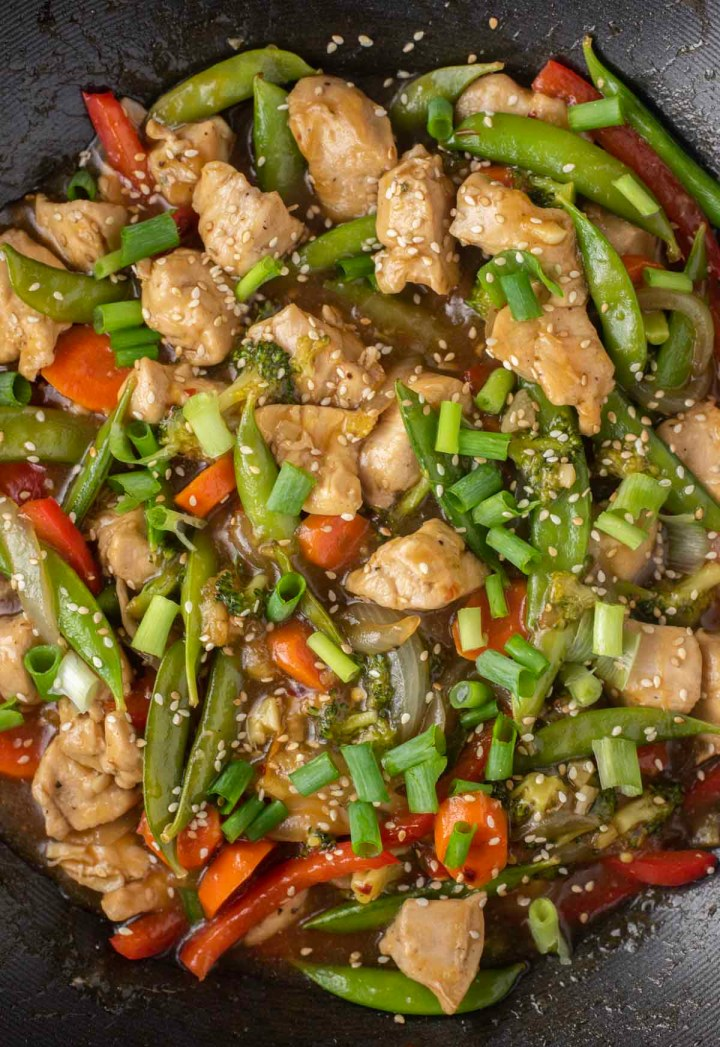 overhead shot of chicken and veggie stir fry in wok