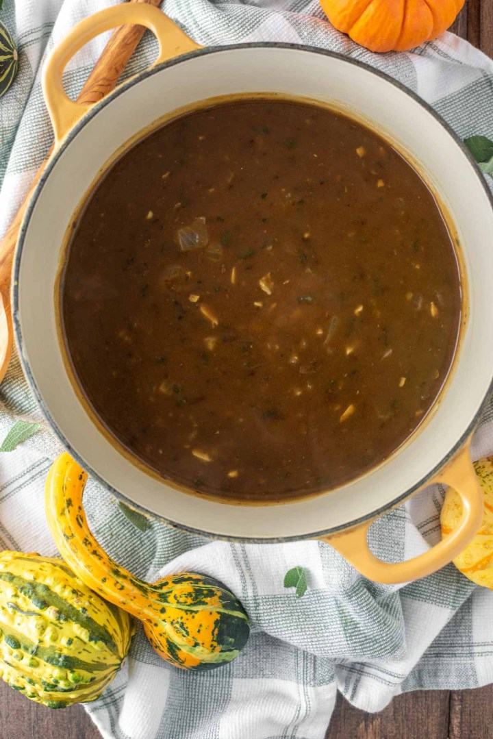 overhead shot of turkey gravy in yellow Dutch oven