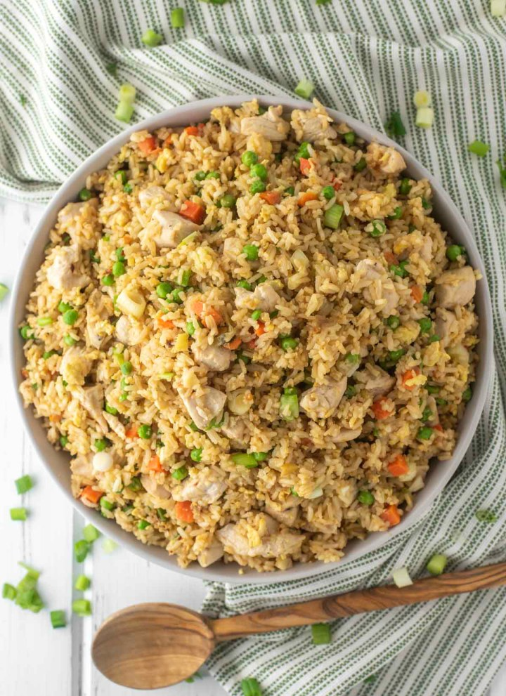 overhead shot of chicken fried rice in bowl on dish towel