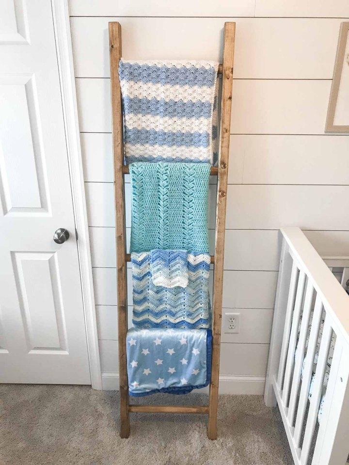 diy blanket ladder against white shiplap with blankets