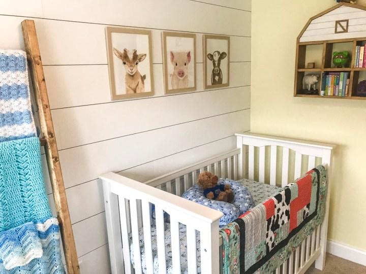 DIY shiplap on wall with crib against it