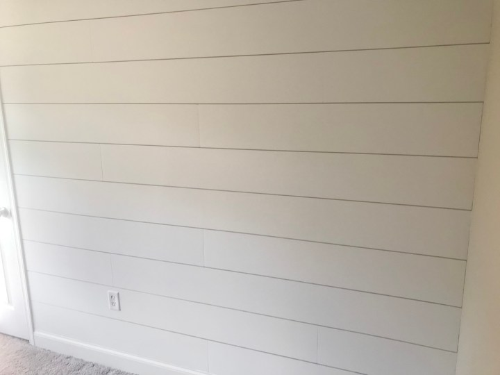 prime and painting DIY shiplap