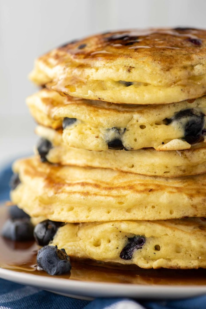 stacked blueberry pancakes on plate