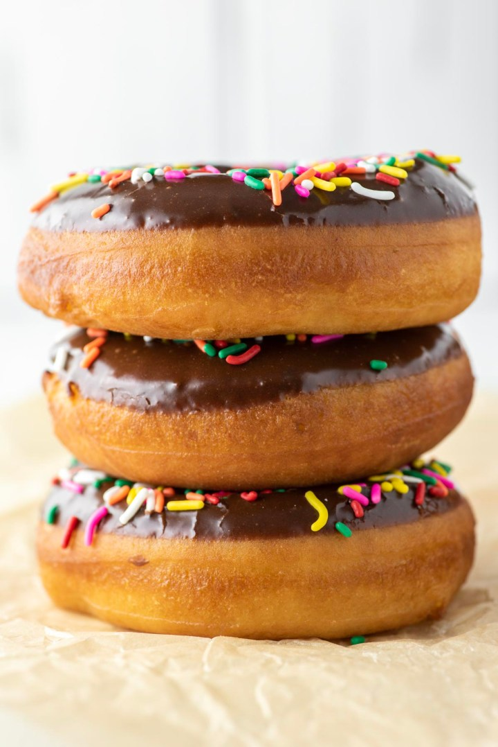 3 chocolate frosted donuts stacked