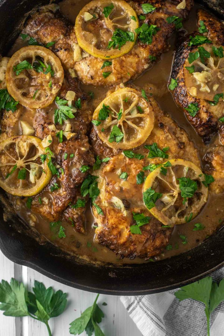 overhead shot of chicken francese in cast iron skillet