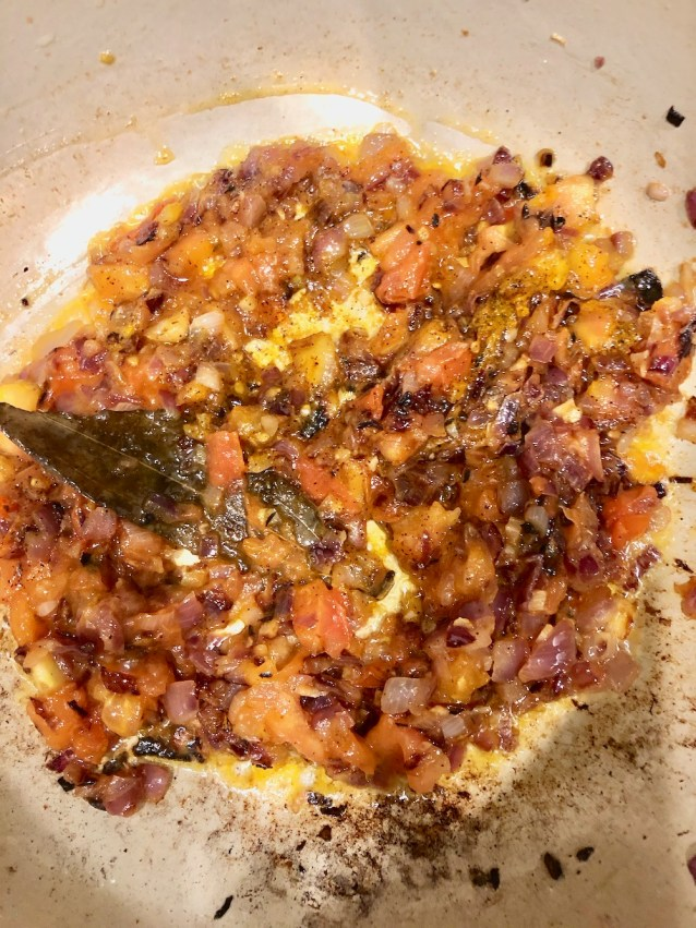 Added in the tomato and spices