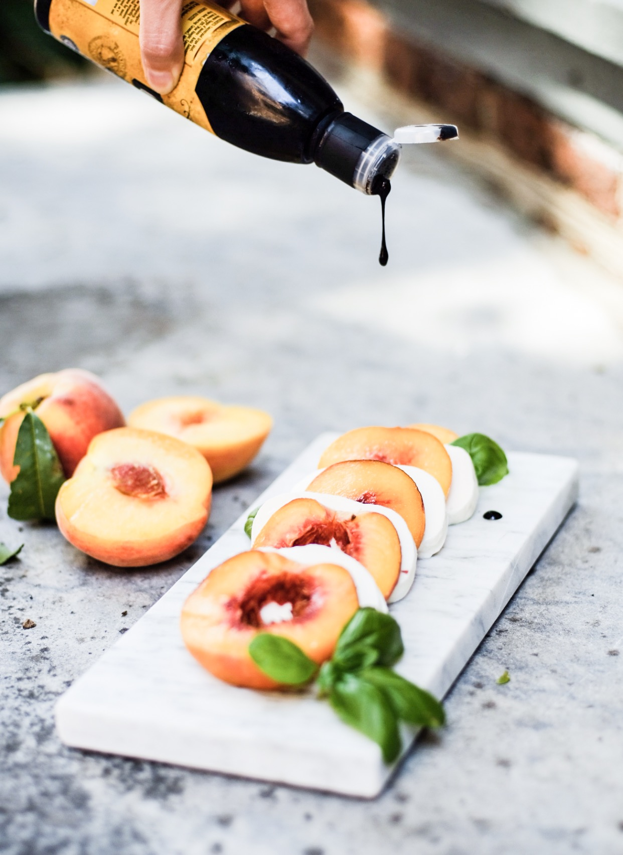 Lifestyle Blogger Chocolate and Lace shares her recipe for Peach Caprese Salad