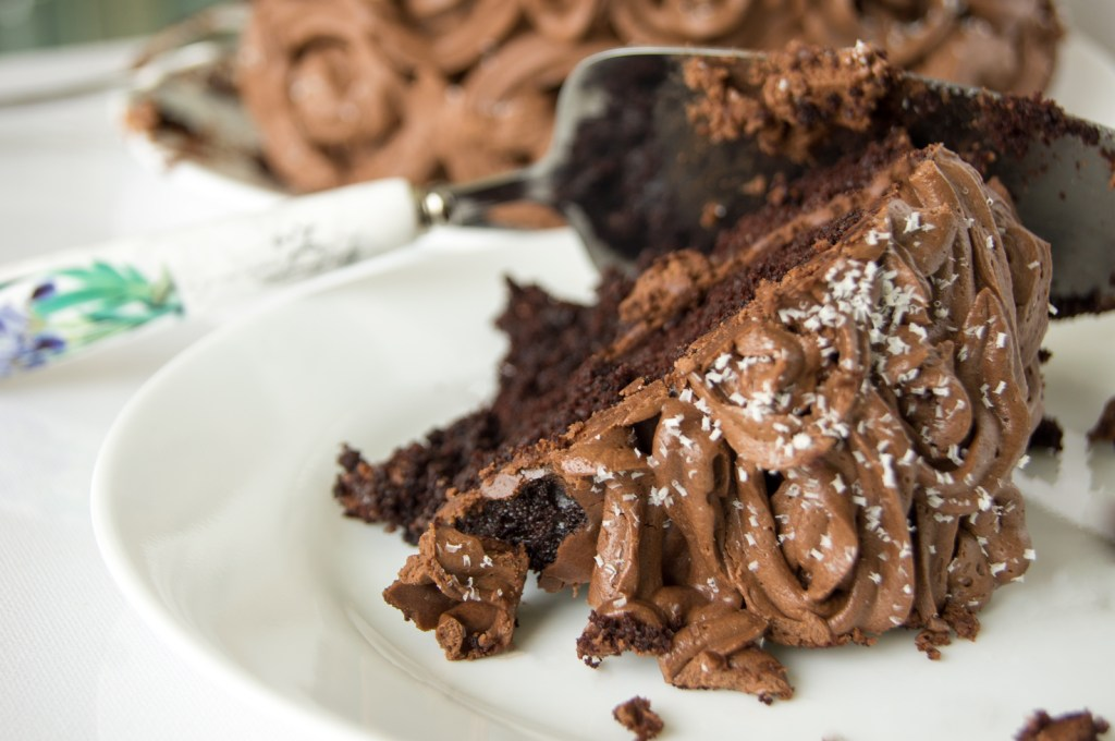 two-layer chocolate cake with whipped cocoa buttercream, chocolate cake, buttercream frosting, whipped cocoa buttercream frosting, buttercream, chocolate, cake, recipe, chocolate cake recipe, birthday cake recipe, birthday cake, birthday recipe, easy cake recipe, easy cake, buttercream recipe, whipped frosting, whipped frosting recipe, whipped buttercream, cocoa buttercream, cacao, cake recipe, cake recipes, recipes, recipe, dessert, cake slice, slice, cake cutter, cake slicer, rossettes, rosettes, rossetes, rosette, how to frost a cake,