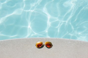 Sunglasses by a pool.