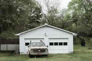car infront of a garage