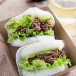 two yakiniku rice burgers served on a takeaway cardboard