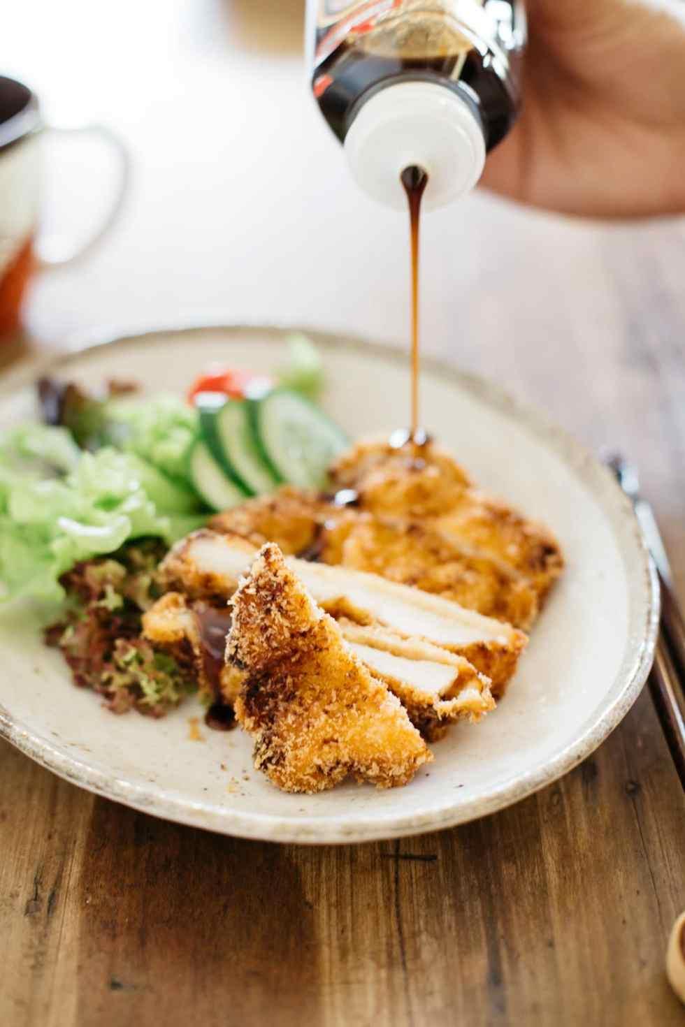 Tonkatsu sauce poured over chicken katsu