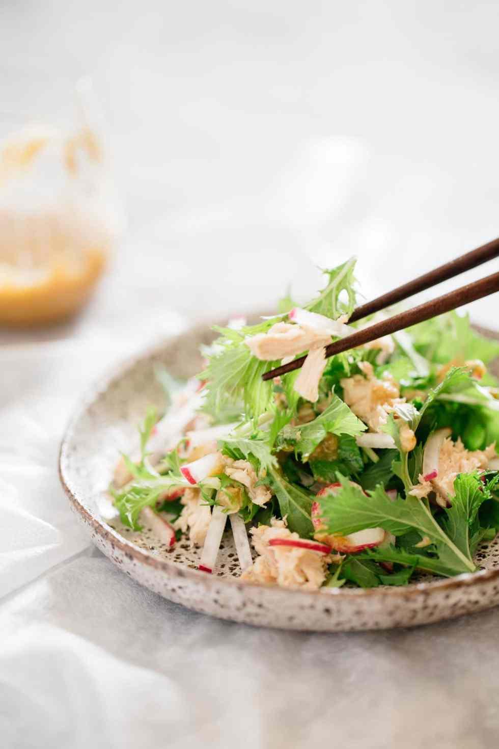 mizuna salad and a pair of chopsticks