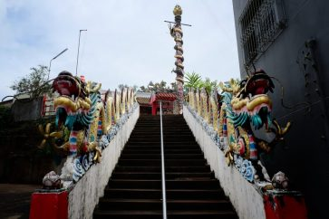 Steps leading to a small Chinese temple.