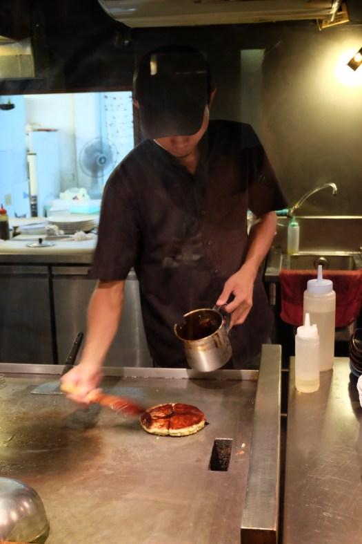 Chef makes okonomiyaki