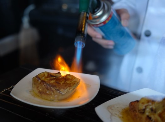 Chef torching foie gras sushi at Gallery Sushi Bangkok