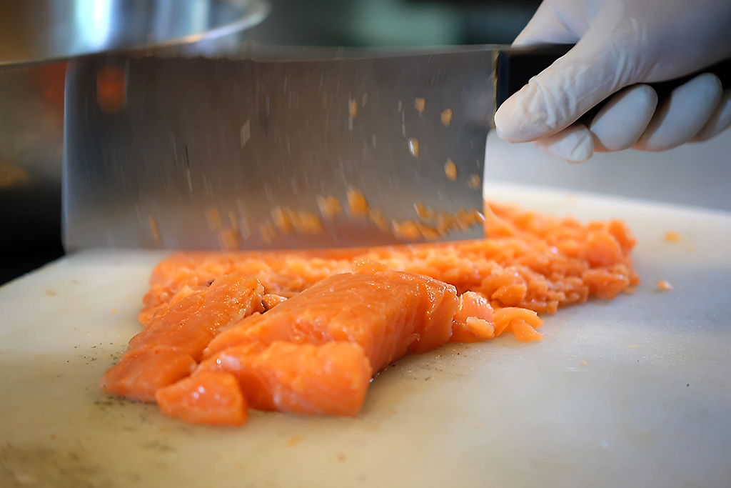 Salmon chopping at Daniel Thaiger Bangkok