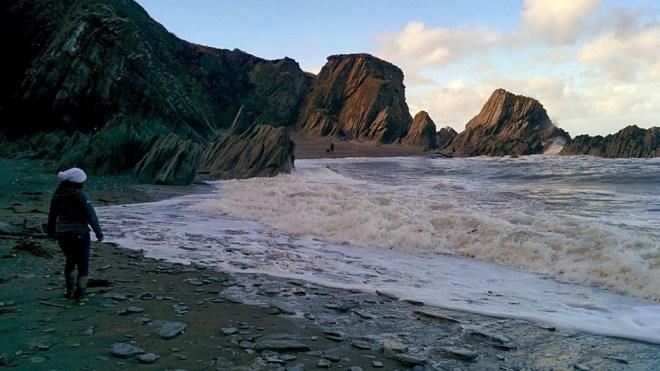 Christa dodging the Incoming tide at Lee Bay, Devon
