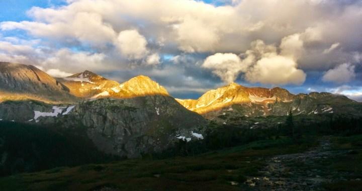 The sun breaking over Mt Jasper in the Indian Peaks