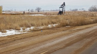 The empty plains are littered with drilling rigs