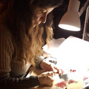 "Christine ""Chris"" Berni of ChrisCrafting working on new jewelry at her beading desk"