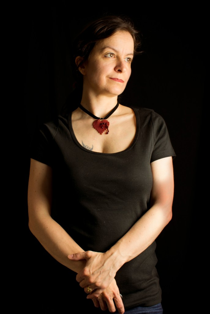 Bleeding Heart Pendant in red worn with Casual outfit