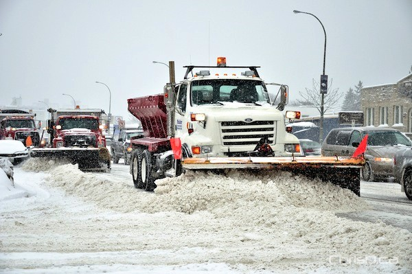 A convoy of snow plows clear Winnipeg streets on Friday, January 28, 2011. (MARC EVANS / CHRISD.CA)