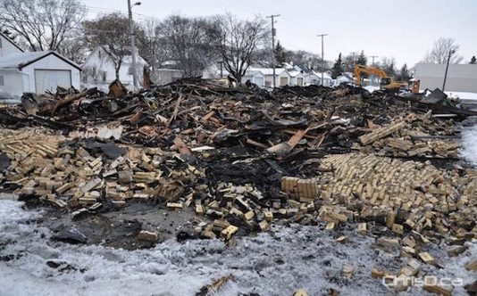 A pile of rubble sits where the East Elmwood Community Centre once stood. Fire completely gutted the building early Wednesday morning. (MAURICE BRUNEAU / CHRISD.CA)